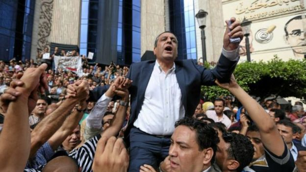 _92560166_160530134923_journalists_carry_yehia_kalash_head_of_the_egyptian_press_syndicate_640x360_reuters_nocredit